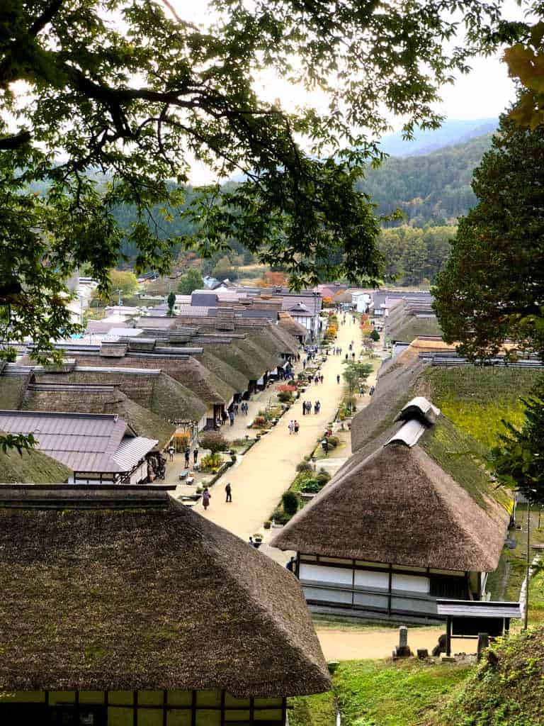 view of thatched roof traditional houses along the Ouchi-juku post town in japan