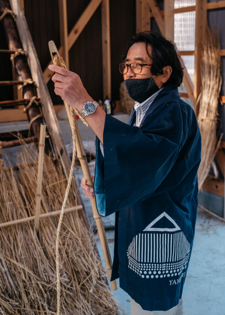 learning how to make traditional japanese thatched roof house in japan near kyoto