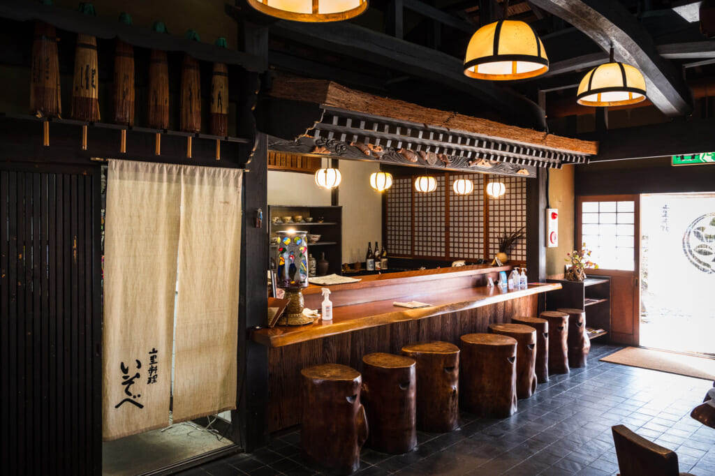 interior of thatched roof ryokan and restaurant near kyoto