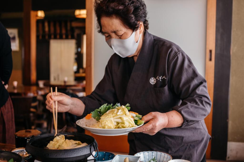 being served traditional Japanese sukiyaki meal