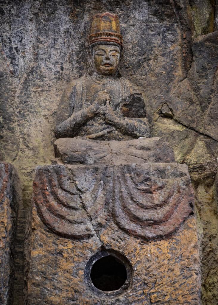 praying buddha statue in usuki, kyushu