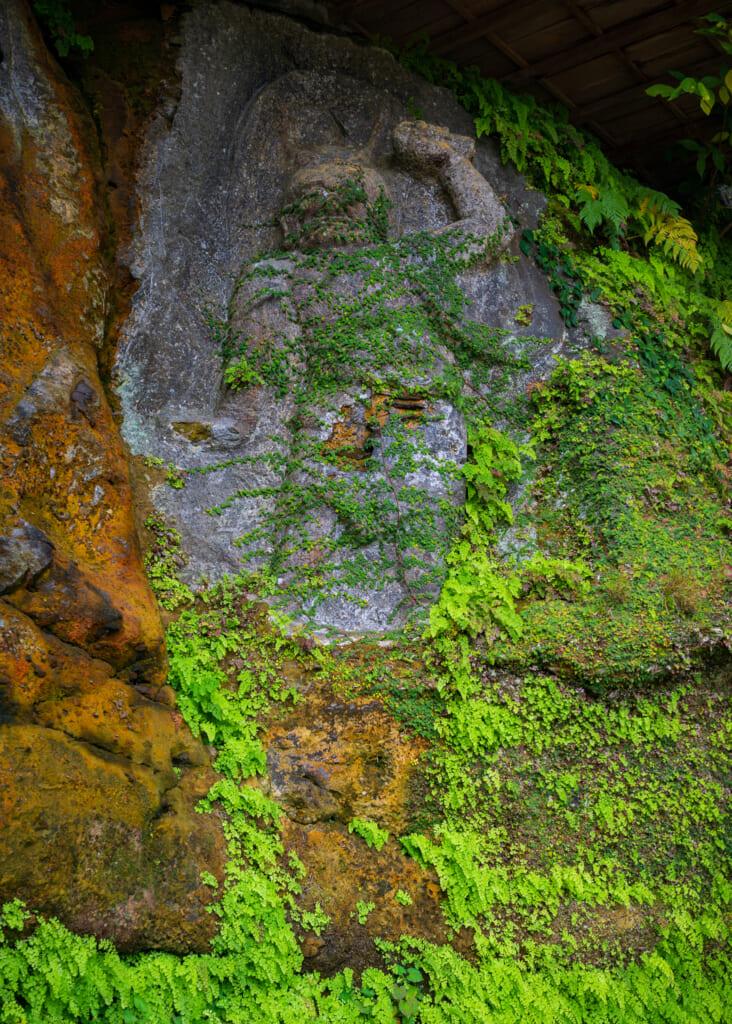moss covered buddhist statue in usuki, kyushu