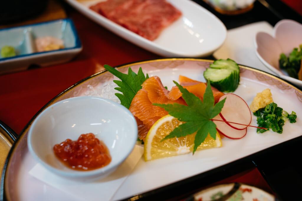 raw fish dish in traditional japanese ryokan in usuki, kyushu