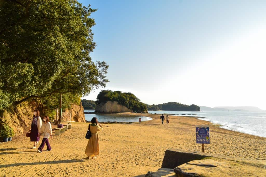 people walking on beach along Angel Road  on Shodoshima, Shikoku island