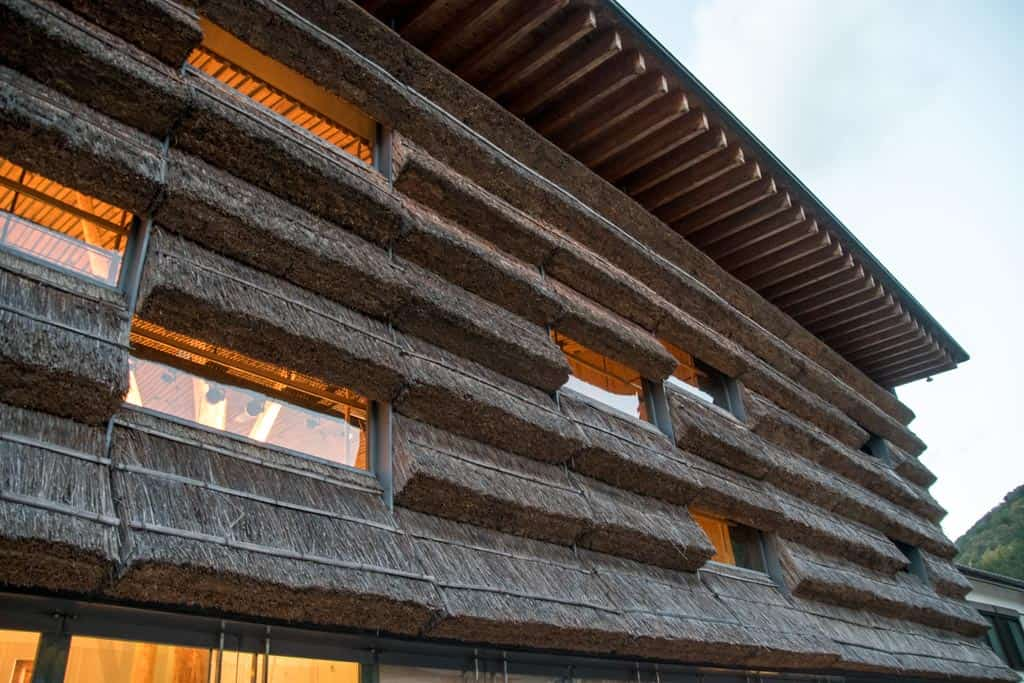 Kengo Kuma's Yusuhara Machino-eki, with thatched roof detailing in Yusuhara Town, Shikoku.