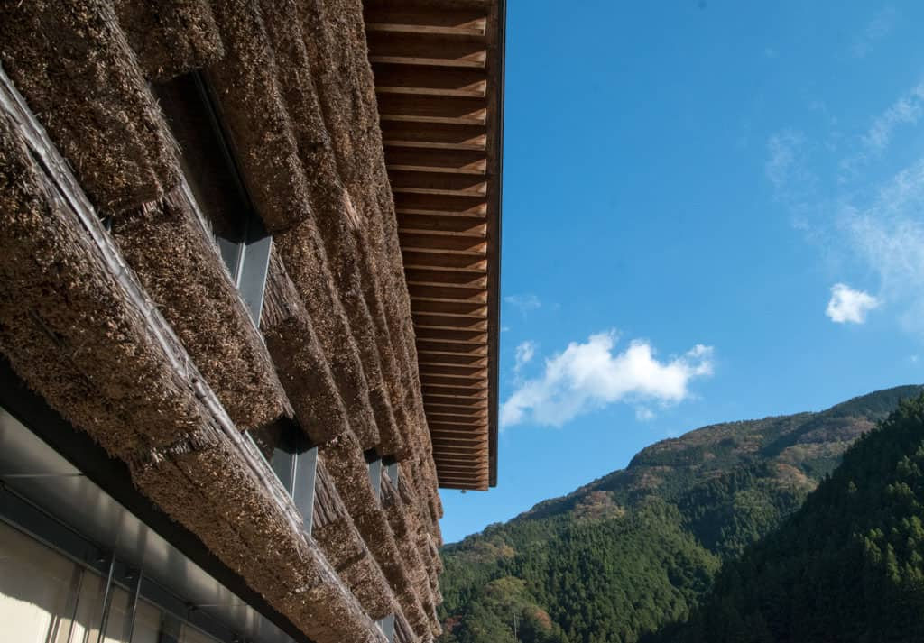 Detail of Kengo Kuma's Yusuhara Machino-eki, with thatched roof detailing in Yusuhara Town, Shikoku.