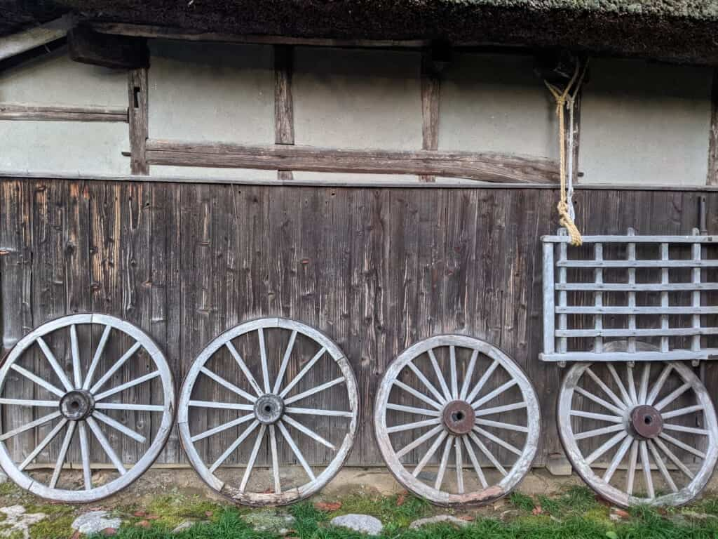 Northern Culture Museum wagon wheels arranged aside an old Japanese house