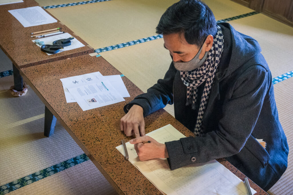 tracing sutra in japanese temple of goto islands
