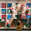 A child in front on a shop window during Christmas Season