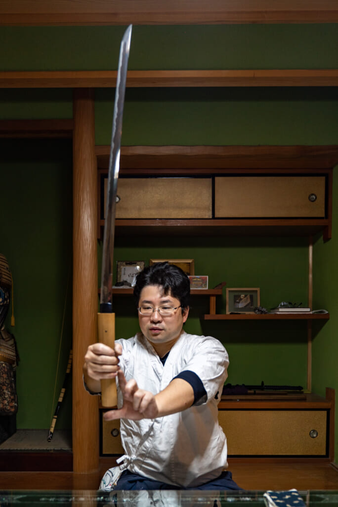 man with japanese samurai sword
