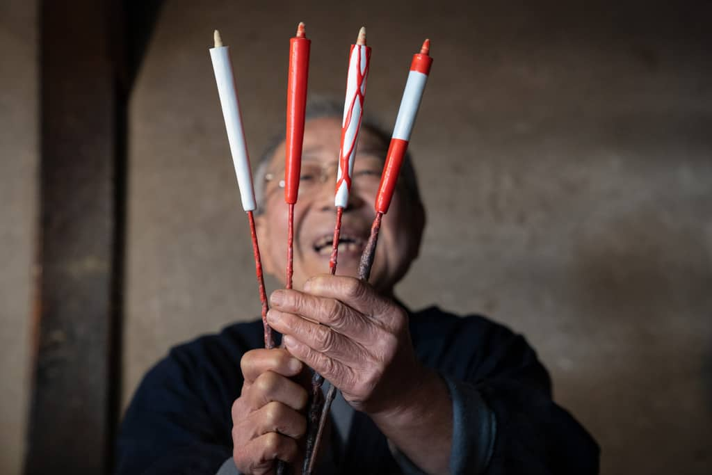 man holds up Traditional japanese candles in workshop in Gifu, Japan