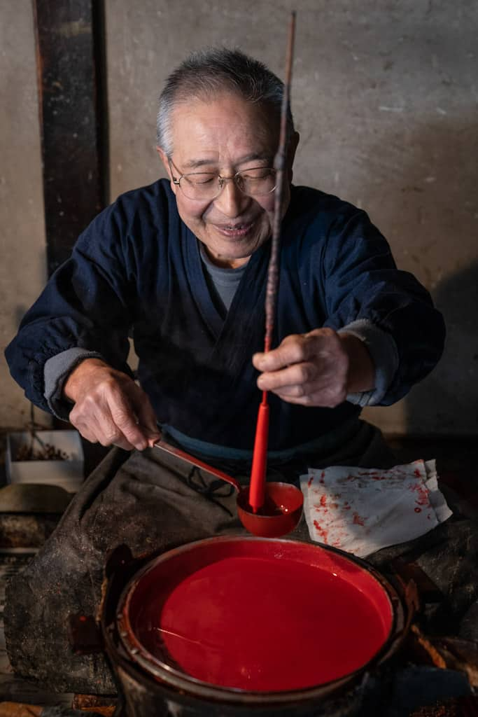 red wax in making of traditional japanese candles in Gifu, Japan