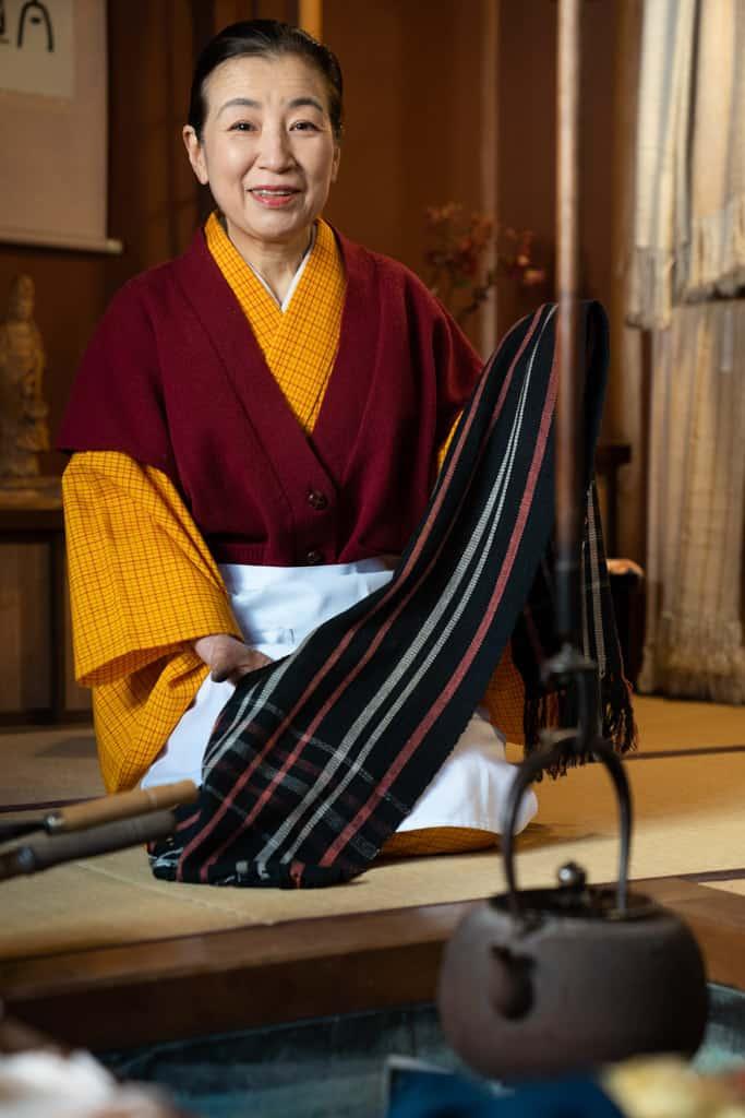 woman holds silk in gifu shop