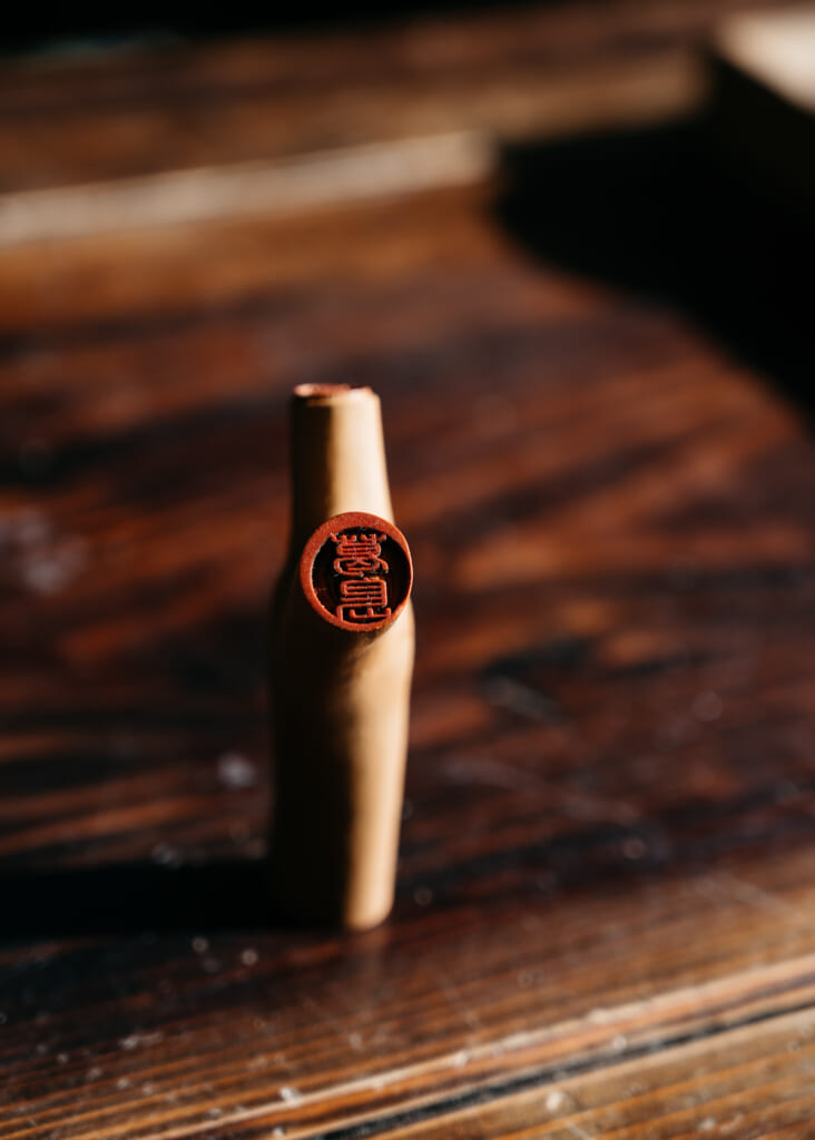 A Japanese hanko carved from a leftover branch of a camellia tree on goto islands