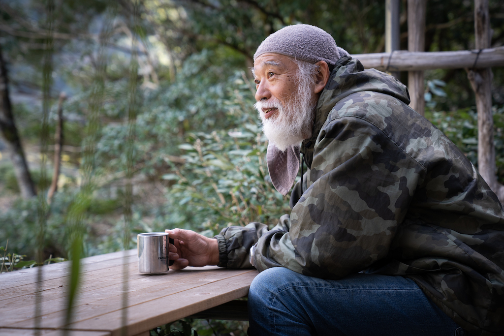Mountain hermit sitting at table