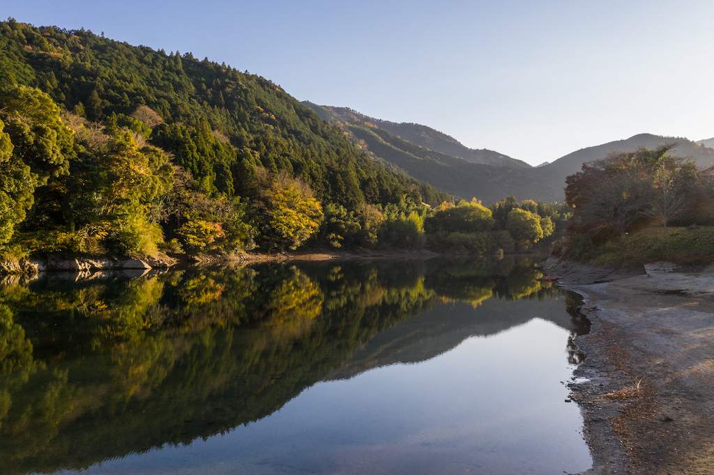 Green mountains reflected in clear water in mie prefecture