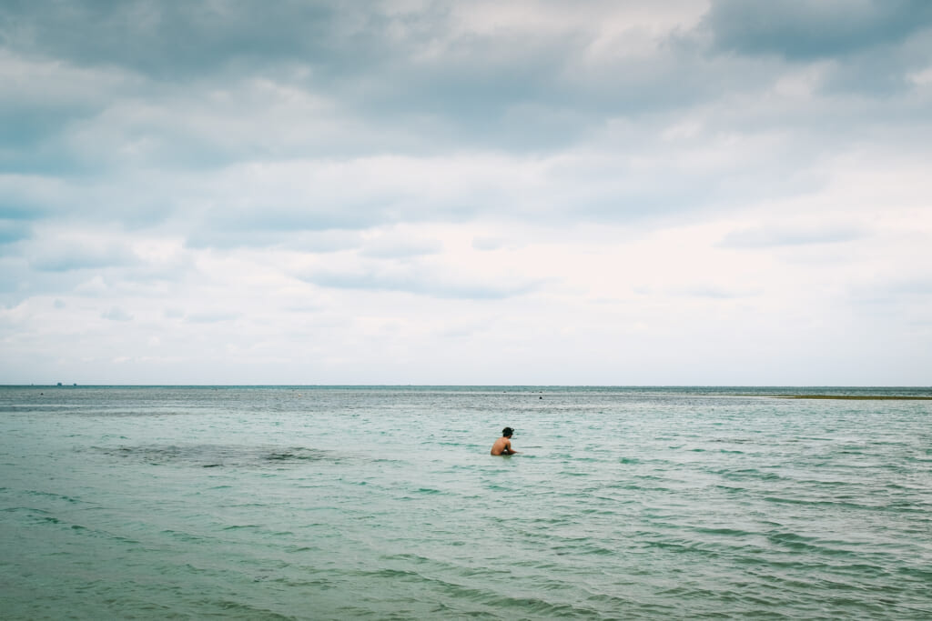 swimming in the ocean for the new year in okinawa