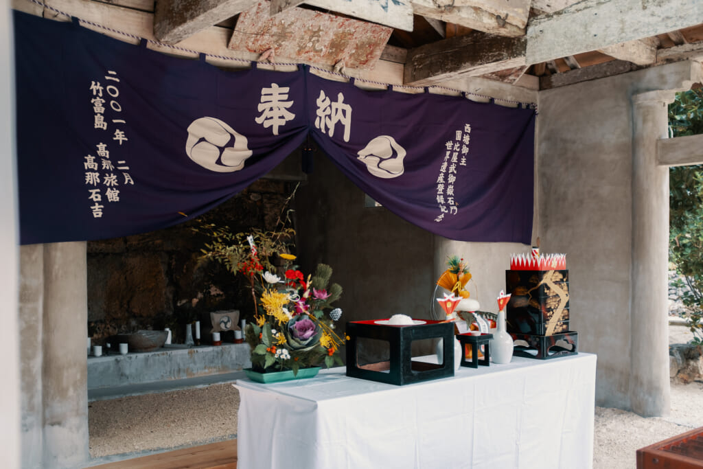 a japanese shrine in okinawa with offerings for the new year