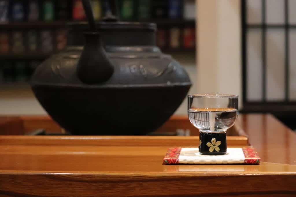 glass of Japanese sake in tatami shop in Japan