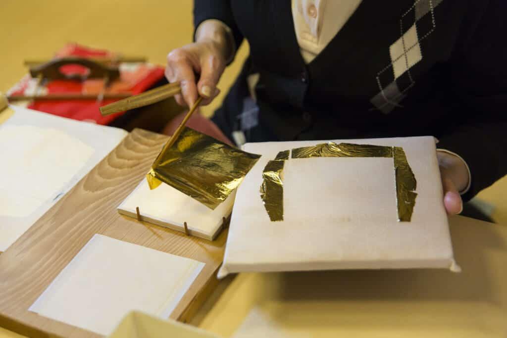 applying gold leaf to card