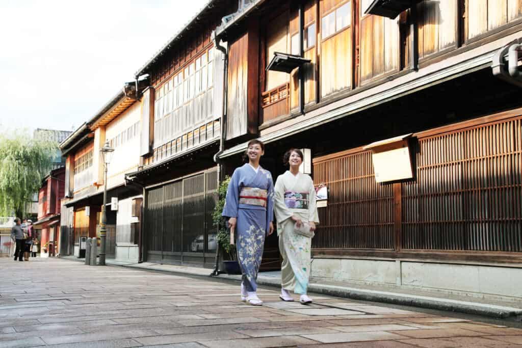 two woman walking through Higashi Chaya district in Kimono