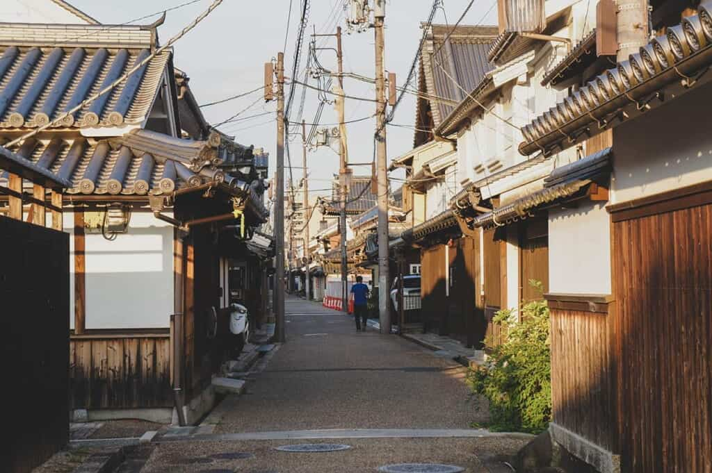 Narrow alley between traditional Japanese houses in Imaicho, Kashihara, Nara