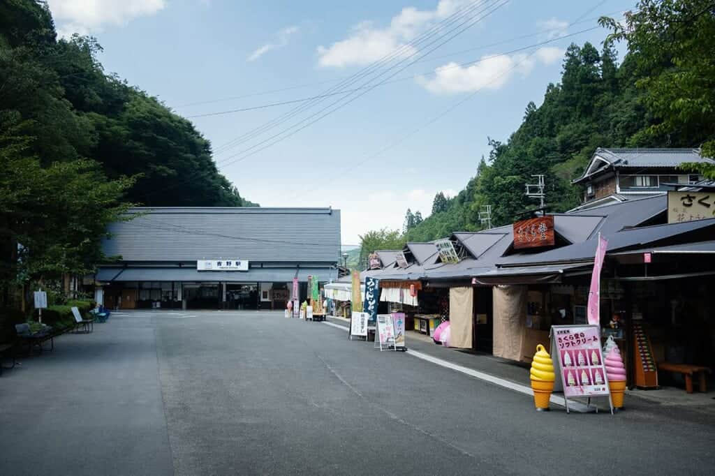 Yoshino train station with souvenir shops before hiking in Japan