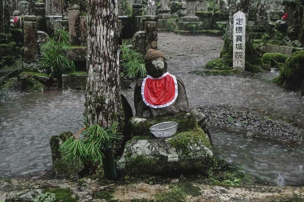 Jizo statue in the rain