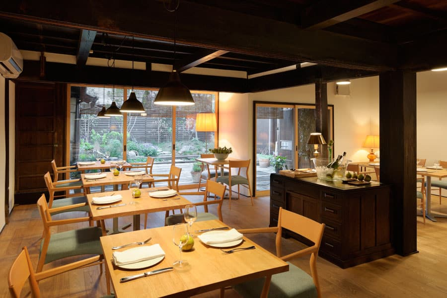 Dining room of a modern Japanese restaurant inside a traditional house