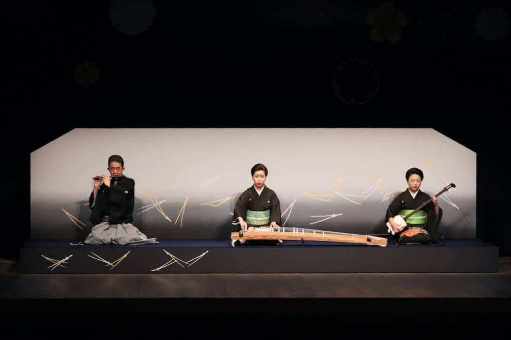 3 musicians playing bamboo flute, koto and shamisen