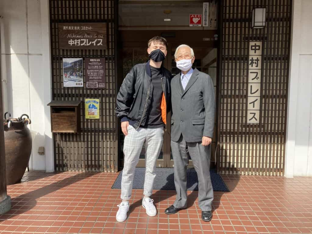 standing with Japanese prosthetics maker in Japan