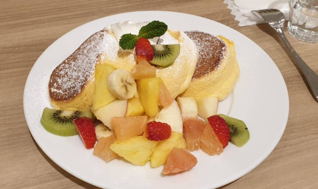Japanese fluffy pancakes with many fruit in cafe in Japan