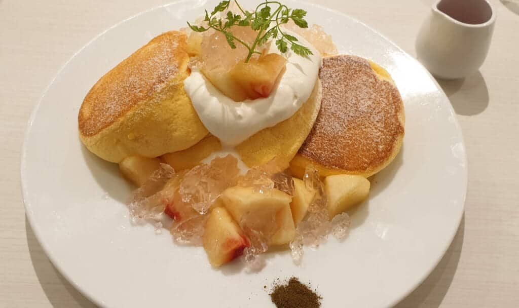 Japaneses fluffy pancakes with peach and jelly served in cafe in Japan