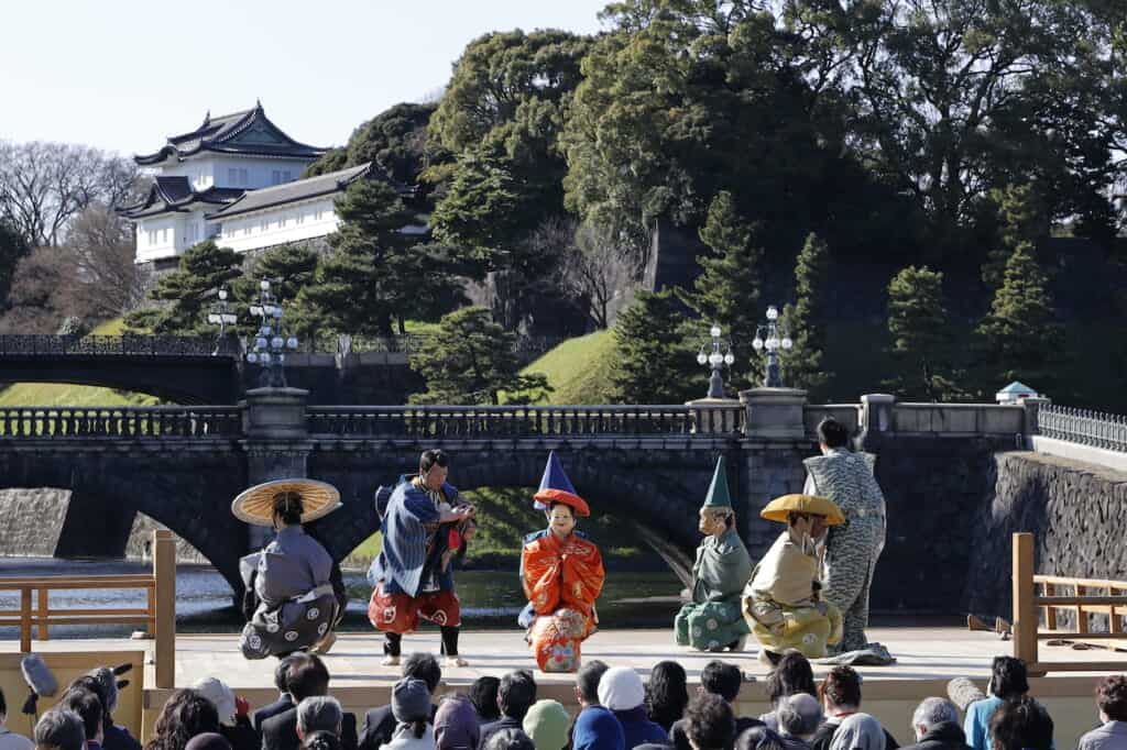 Traditional Japanese Kyogen Noh performers on stage in front of Imperial Palace in Japan