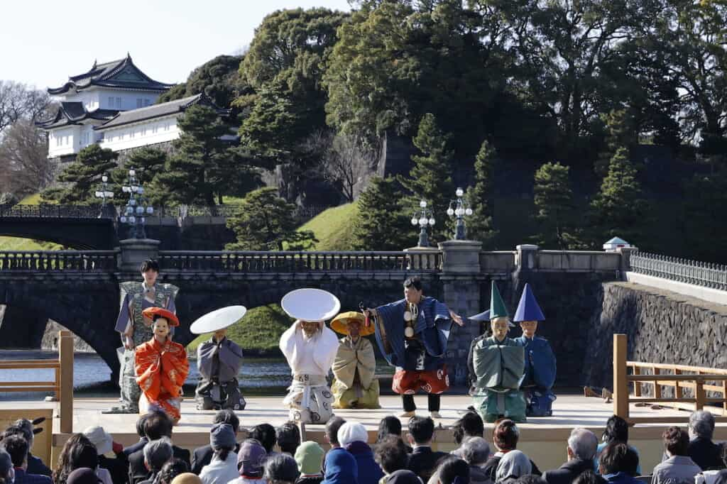 Traditional Japanese Kyogen  Noh performers on stage in front of Japan's Imperial Palace