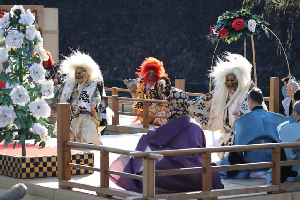Traditional Japanese Noh lion dance performers on stage in Japan