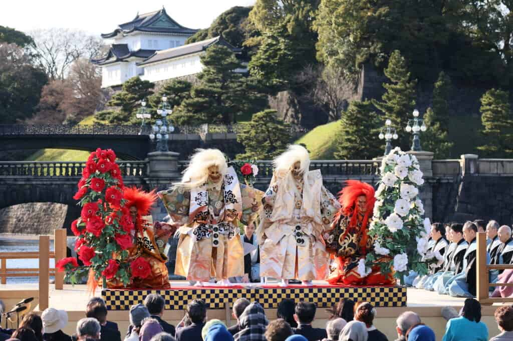 Traditional Japanese Noh dance where 2 white shishi and 2 red shishi on stage in front of Imperial Palace in Japan