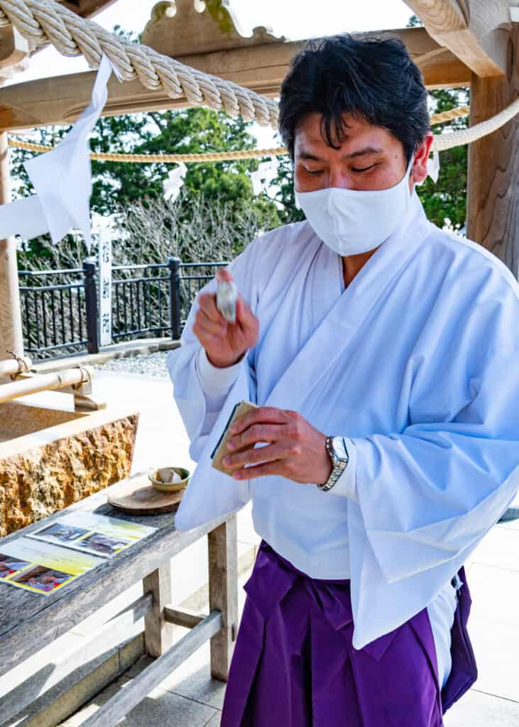 Japanese shrine priest shows purification by fire at akihasan jinja in Japan