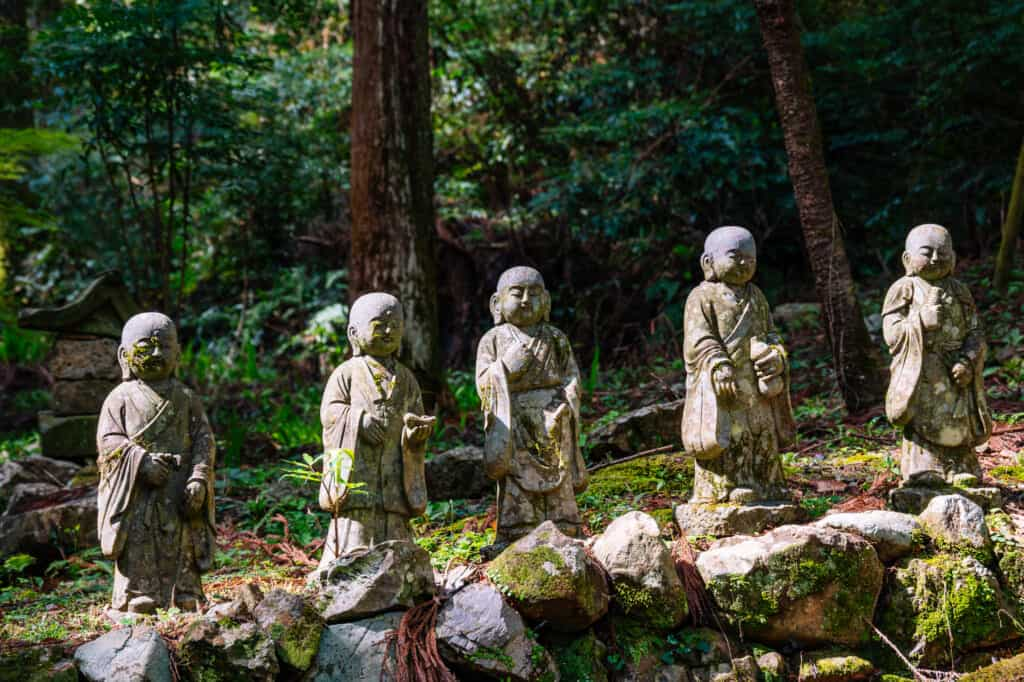 Japanese stone statues in forest