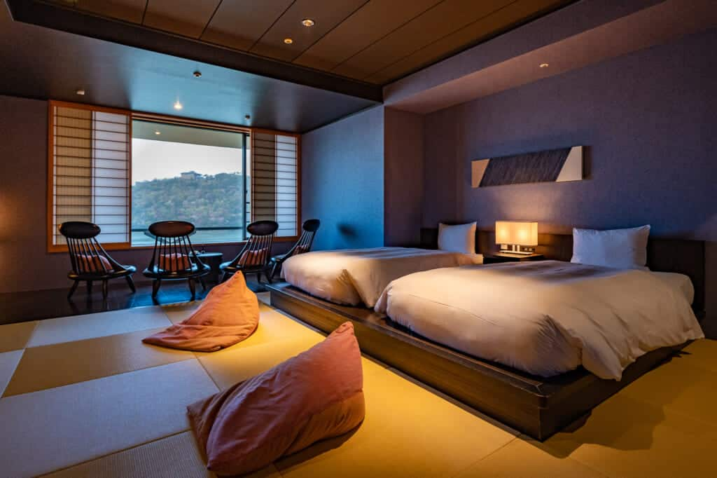 Luxury Japanese guest room with tatami and beds at hoshino resorts kai enshu in Japan