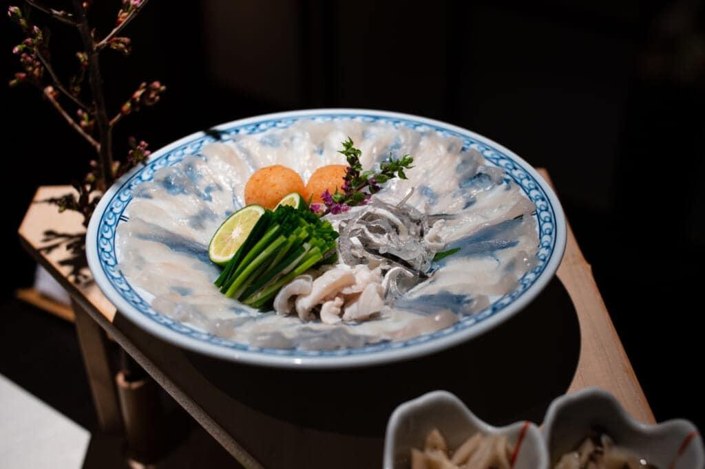 traditional Japanese delicacy, fugu blowfish sashimi at hoshino resorts kai enshu