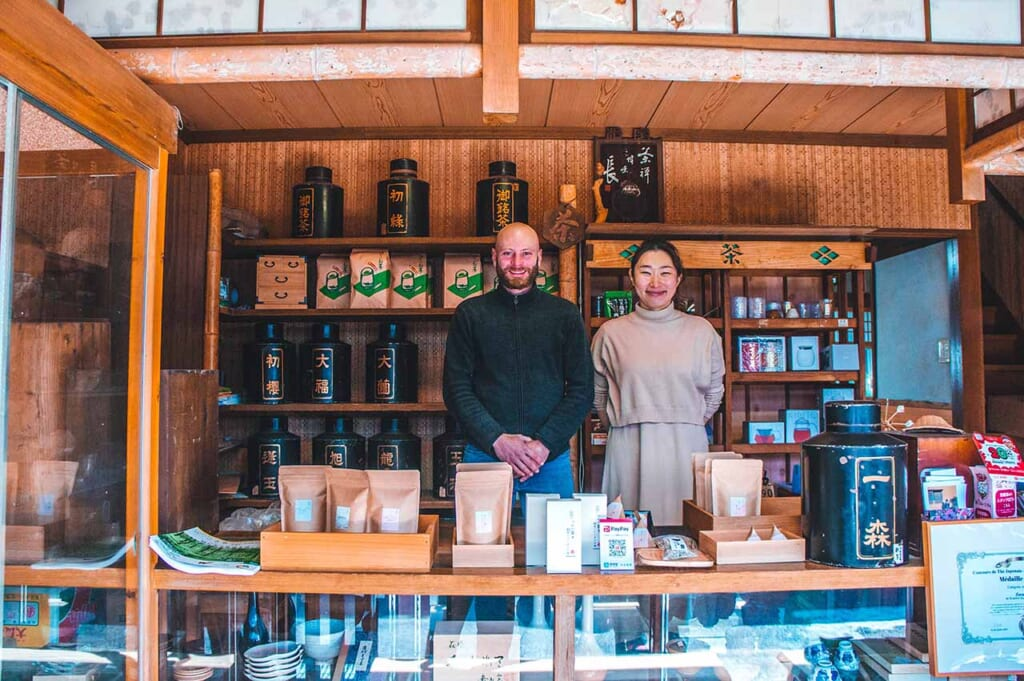French-Japanese couple standing in their shop in Japan