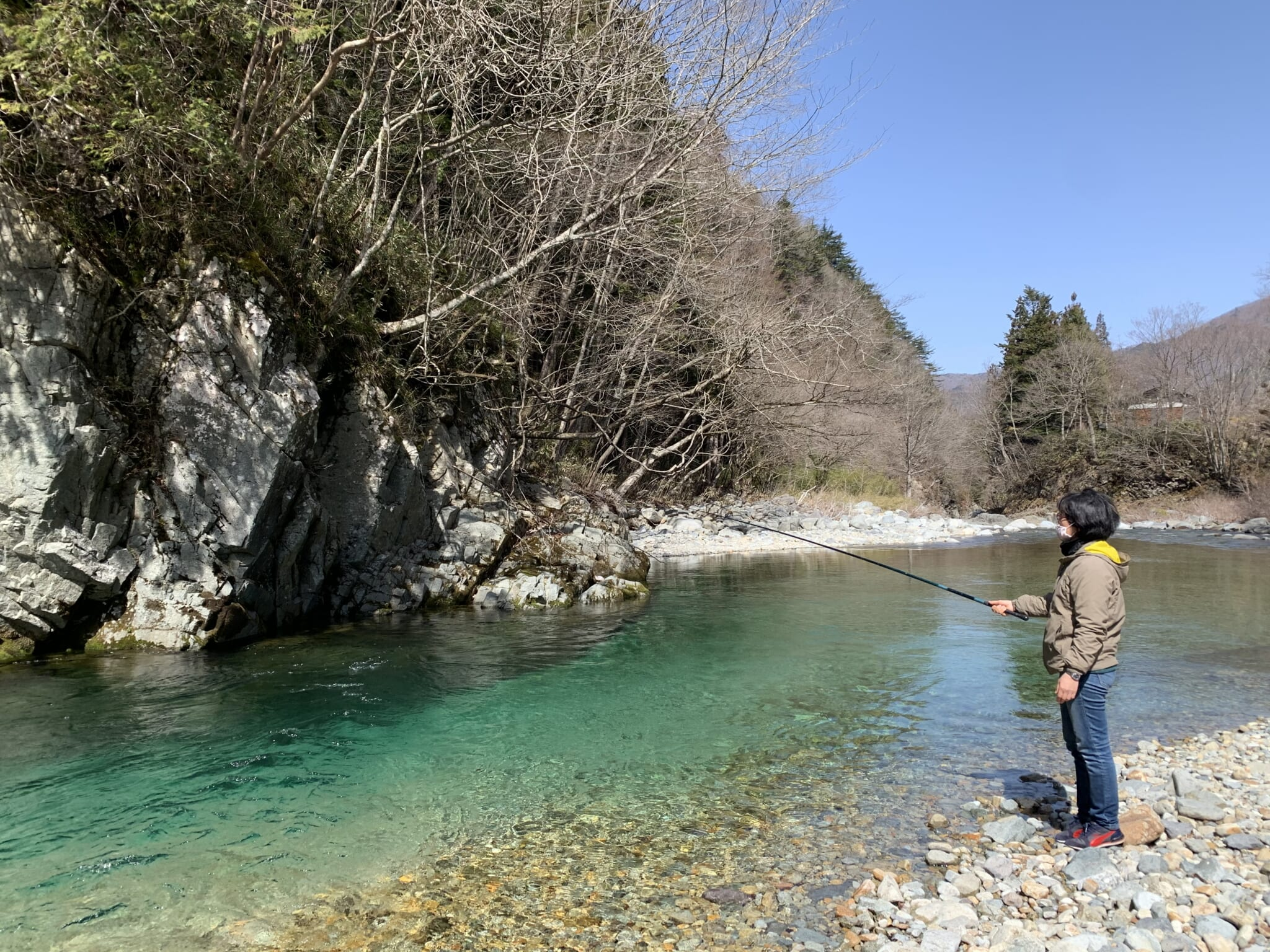 person line fishing in a river in Japan