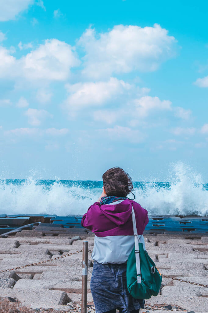 standing in front of Japanese waves in Japan