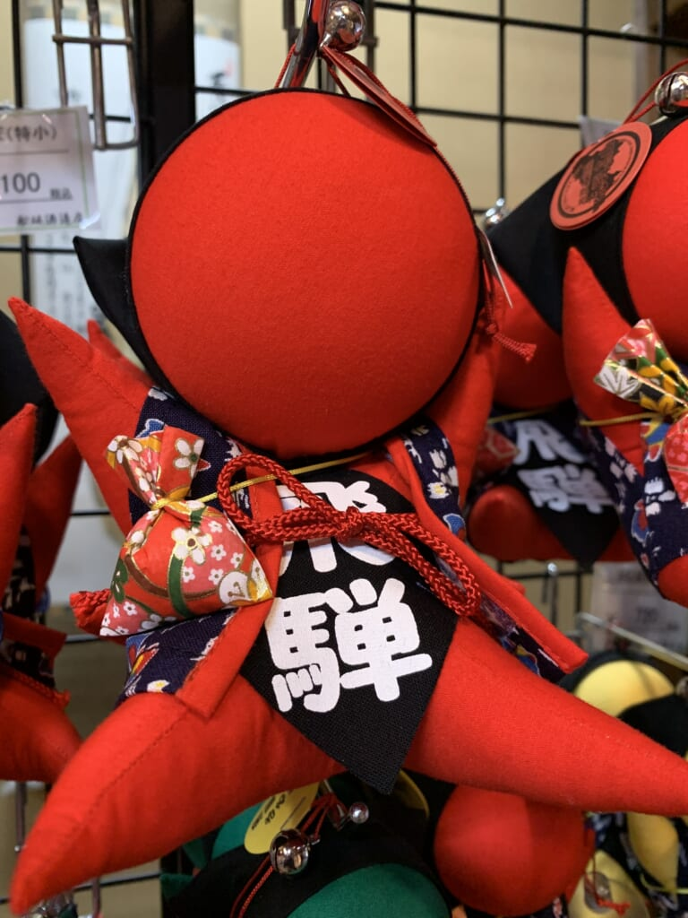 traditional JApanese red sarubobo doll