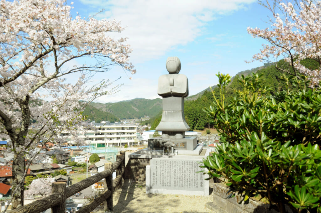 stone statue in a rural Japanese landscape in Gifu, Japan