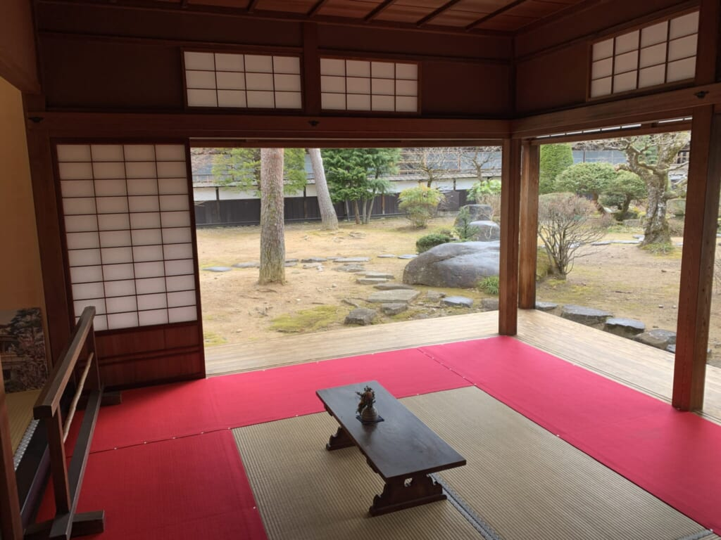 red carpeted tatami room with low table