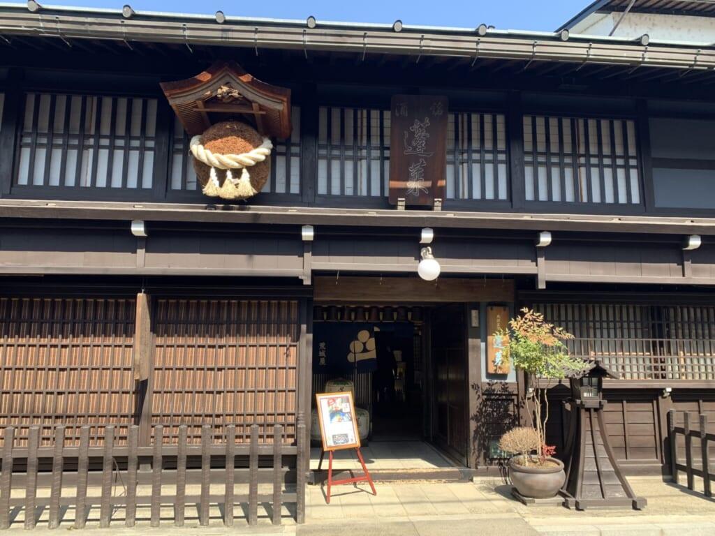 traditional japanese sake brewery entrance with sugidama in gifu, Japan
