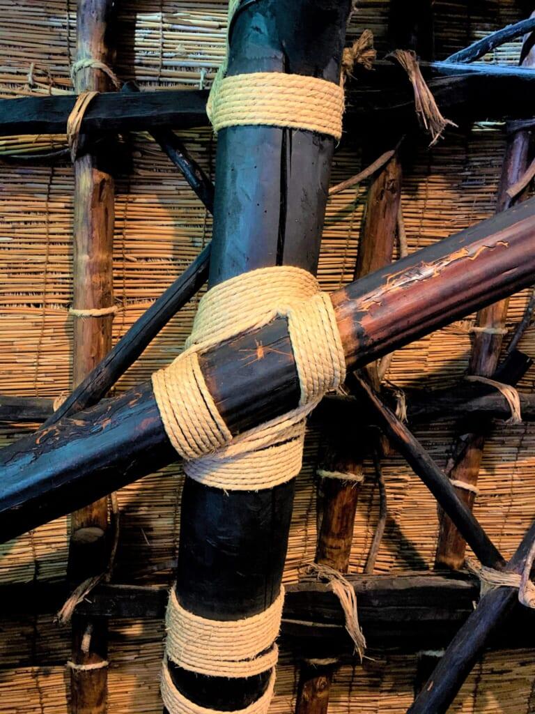 beams tied with rope in a Japanese gassho-style house in Shirakawago, Gifu, Japan