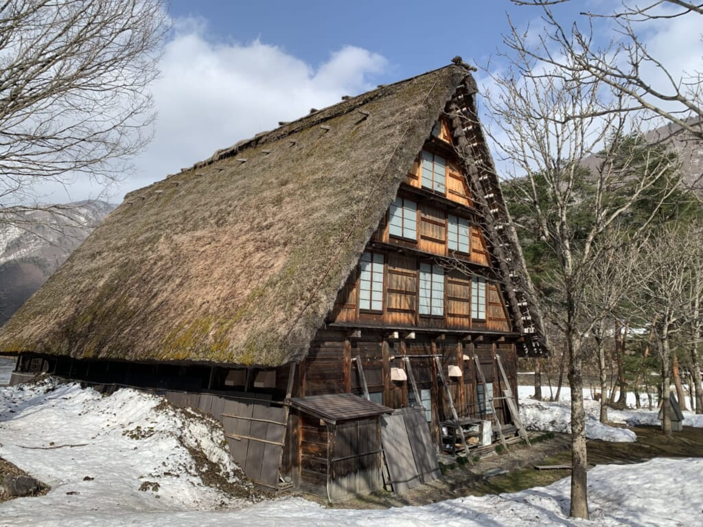 Traditional Japanese thatched house surrounded by snow in Shirakawa-go, Gifu, Japan